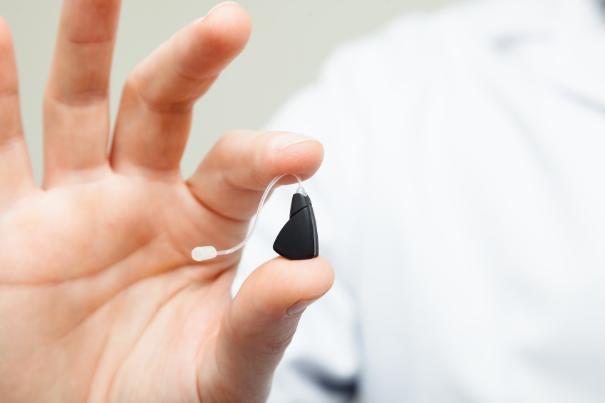 Small digital hearing aid in hand