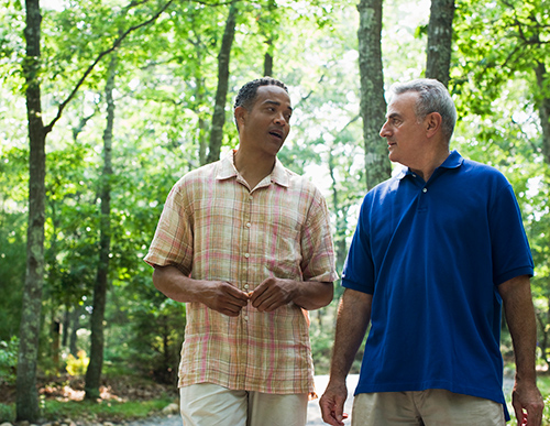 Picture of two guys talking to each other | What to do Do When A Friend Really Needs To Get Their Hearing Tested  title=