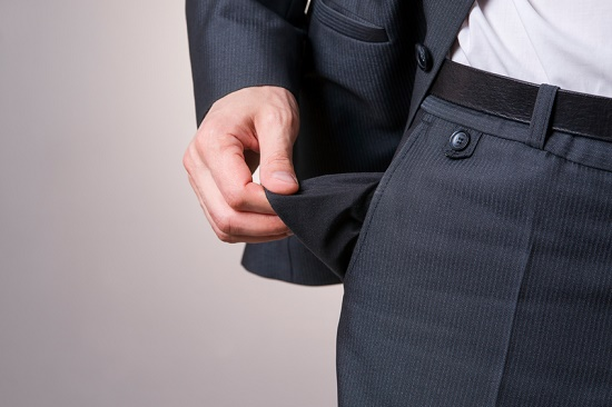 Businessman holding empty pocket