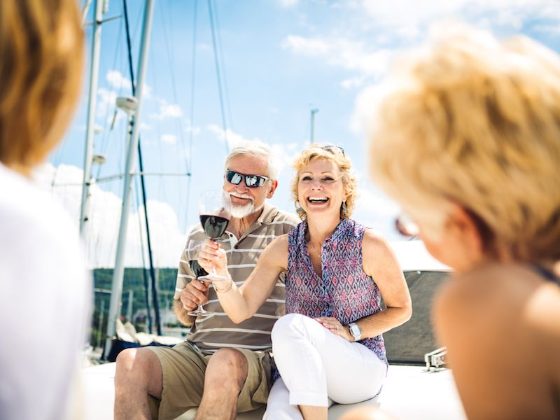 Couple wearing hearing aids with glasses enjoy a vacation.