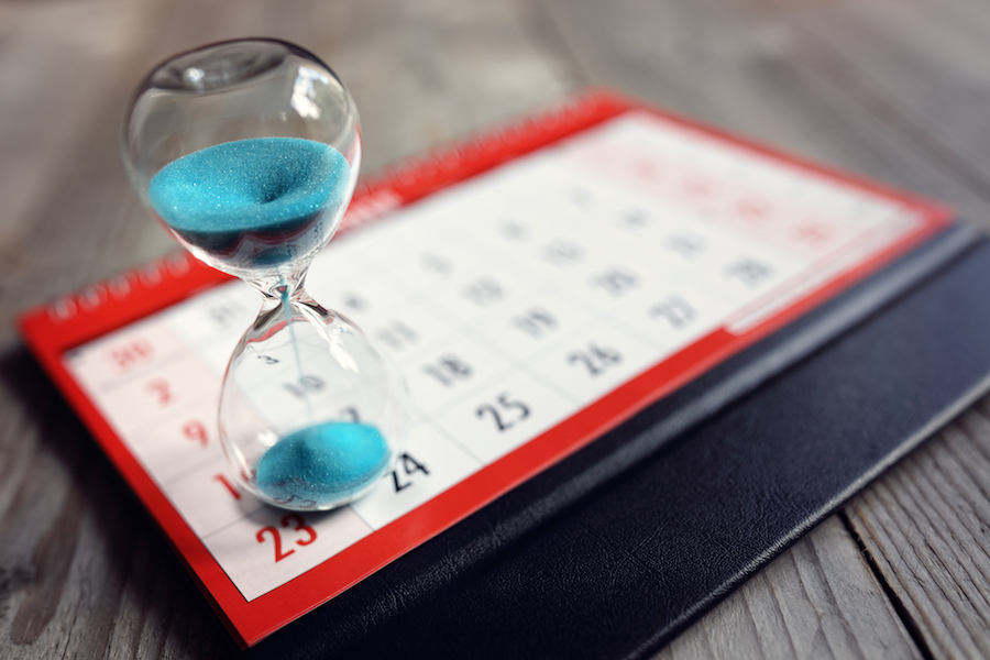 Calendar and hourglass suggesting limited time to get a hearing aid