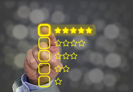 Man pointing finger at 5 stars