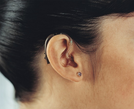 Closeup of hearing aids in ear