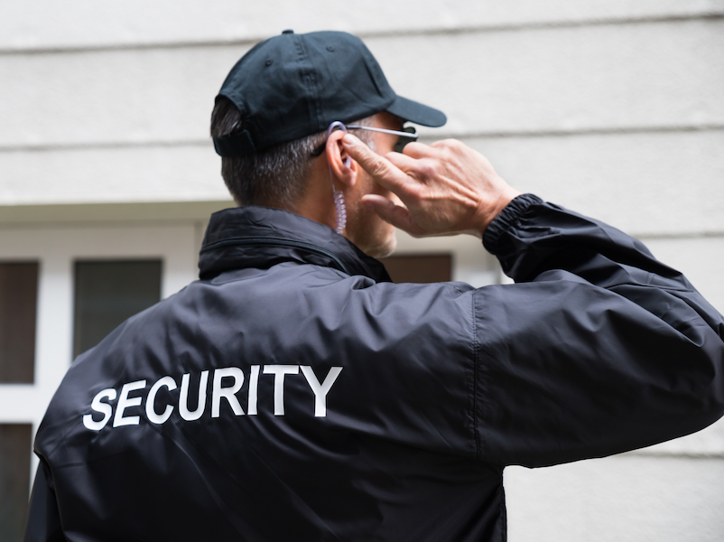 Man wearing security jacket is meant to represent practices that can keep you safe when you have hearing loss.