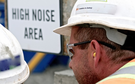 Construction worker wearing earplugs