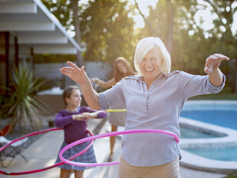 Woman not letting hearing loss and use of hearing aids stop her from feeling young and playing with her grandkids.