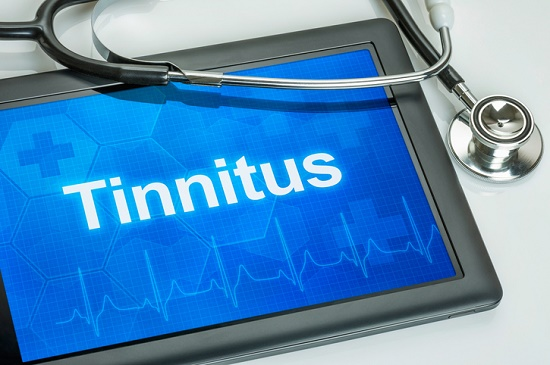 A tablet computer with the words tinnitus on the screen.