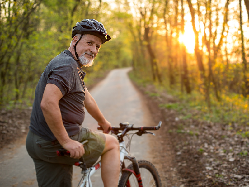 Picture of a senior riding his bike