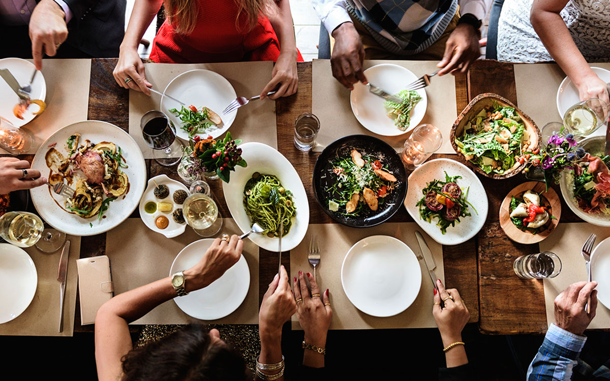Image of a dinner table filled with foods thought to make ringing in the ears worse.