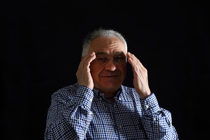 Man hiding his hearing aids