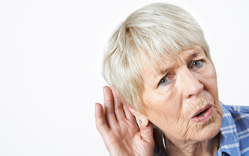 Picture of woman who is struggling to hear.