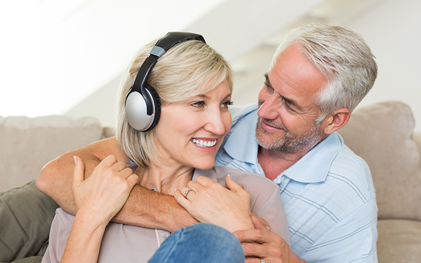 Couple talking about hearing loss.