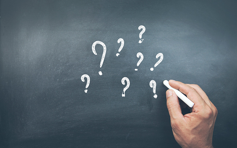 Picture of chalkboard with question marks