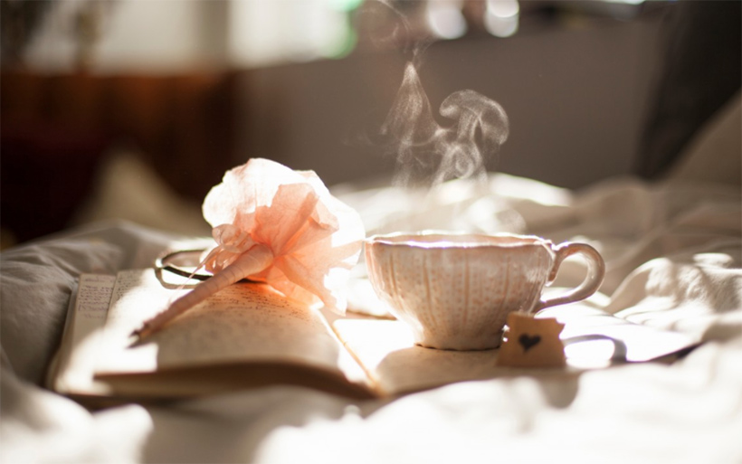 Picture of a journal and tea with a rose