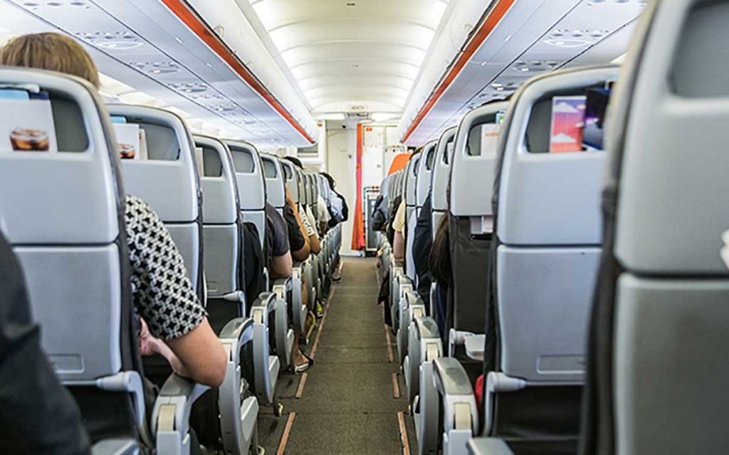 People on a plane. Traveling and Tinnitus.