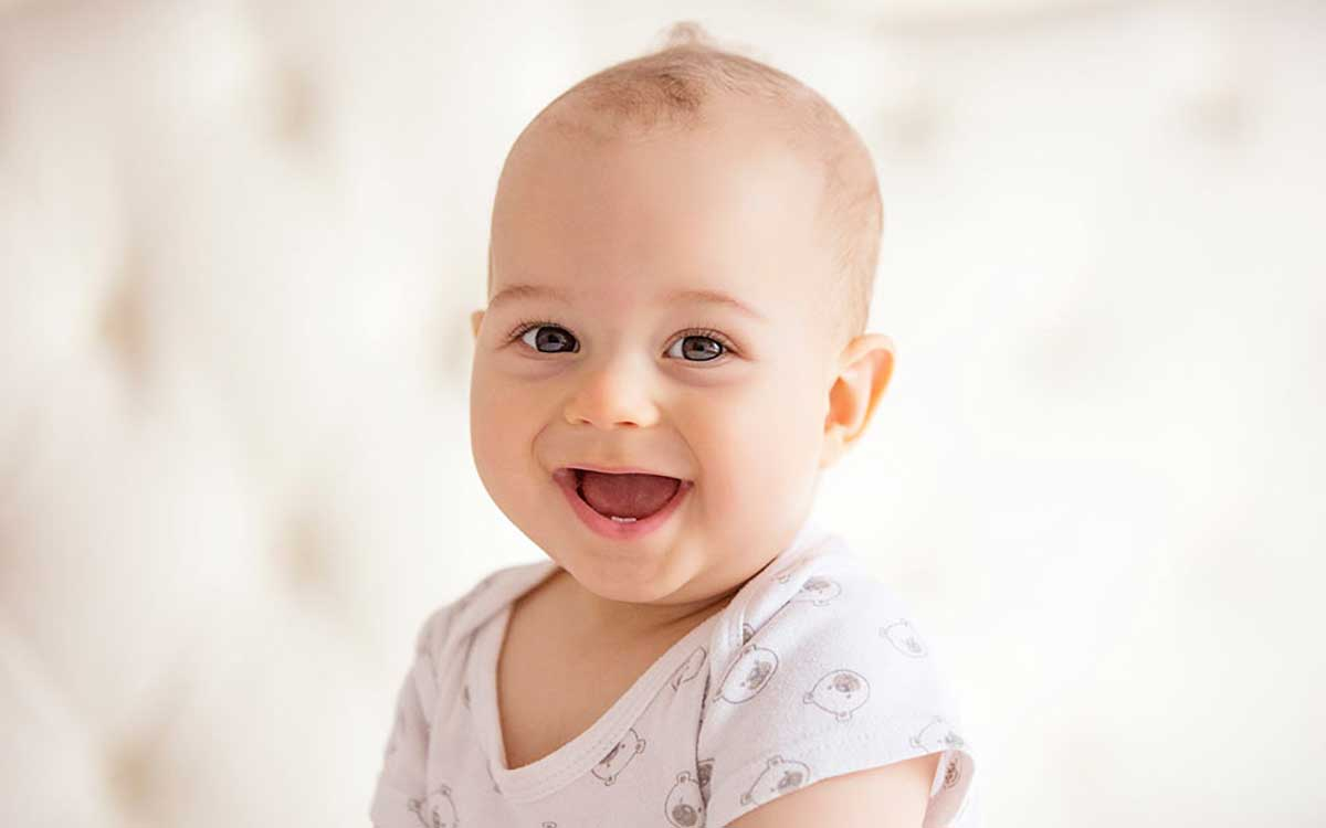 Happy baby. What are you missing by suffering from hearing loss?