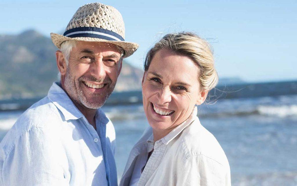 Happy couple avoiding hearing loss by be proactive.