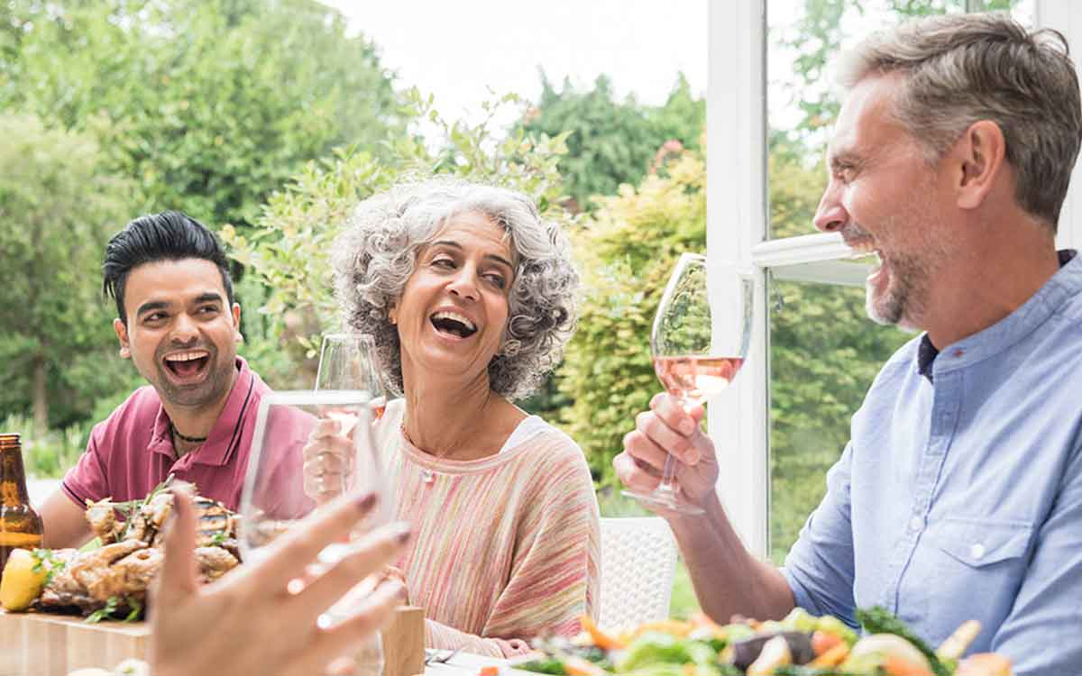People having dinner during the Summer with hearing loss.