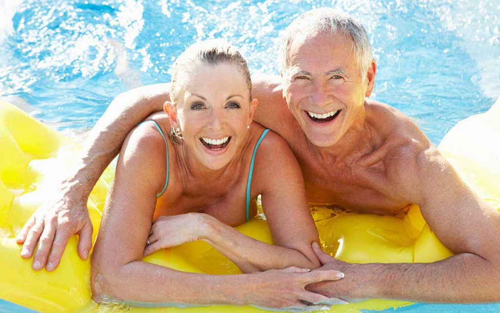 Senior couple swimming in a pool