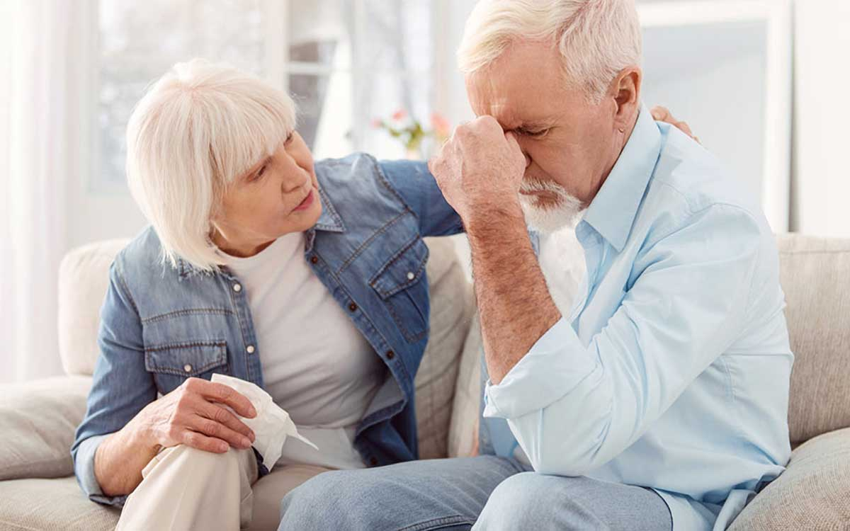 Concerned man and wife over hearing loss emergency.