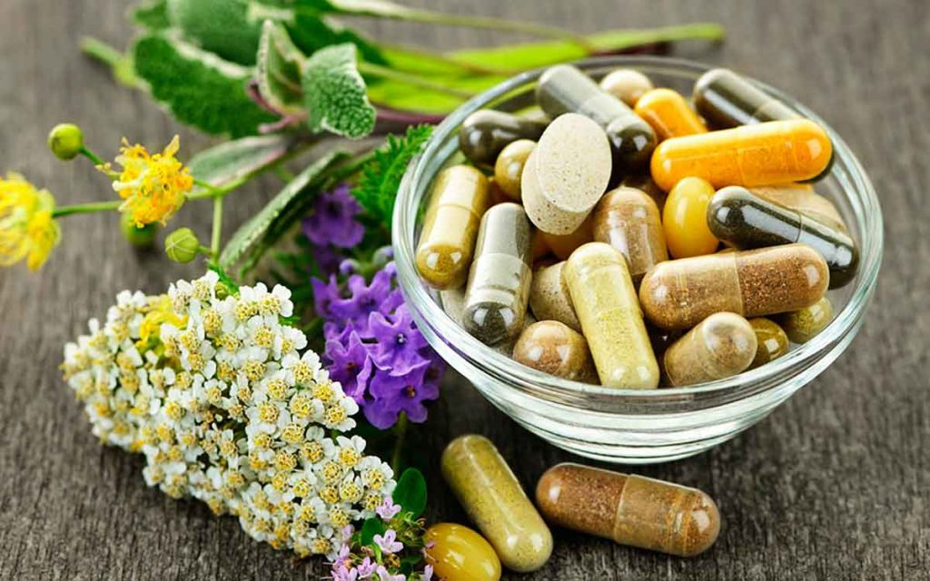 Vitamins on a table which may help hearing loss.