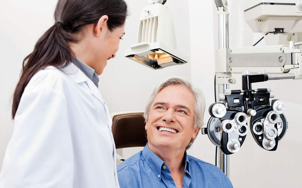 Middle aged man getting his vision tested because of hearing loss.