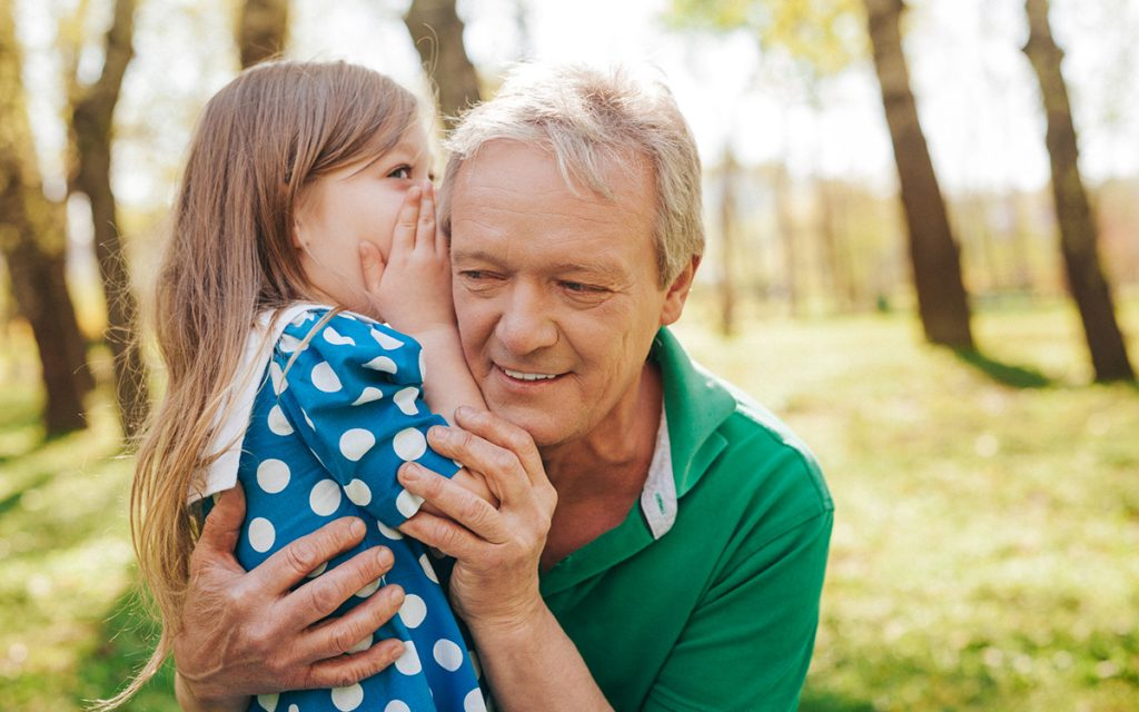 Grandfather suffering from unilateral hearing loss and struggling to hear his granddaughter.