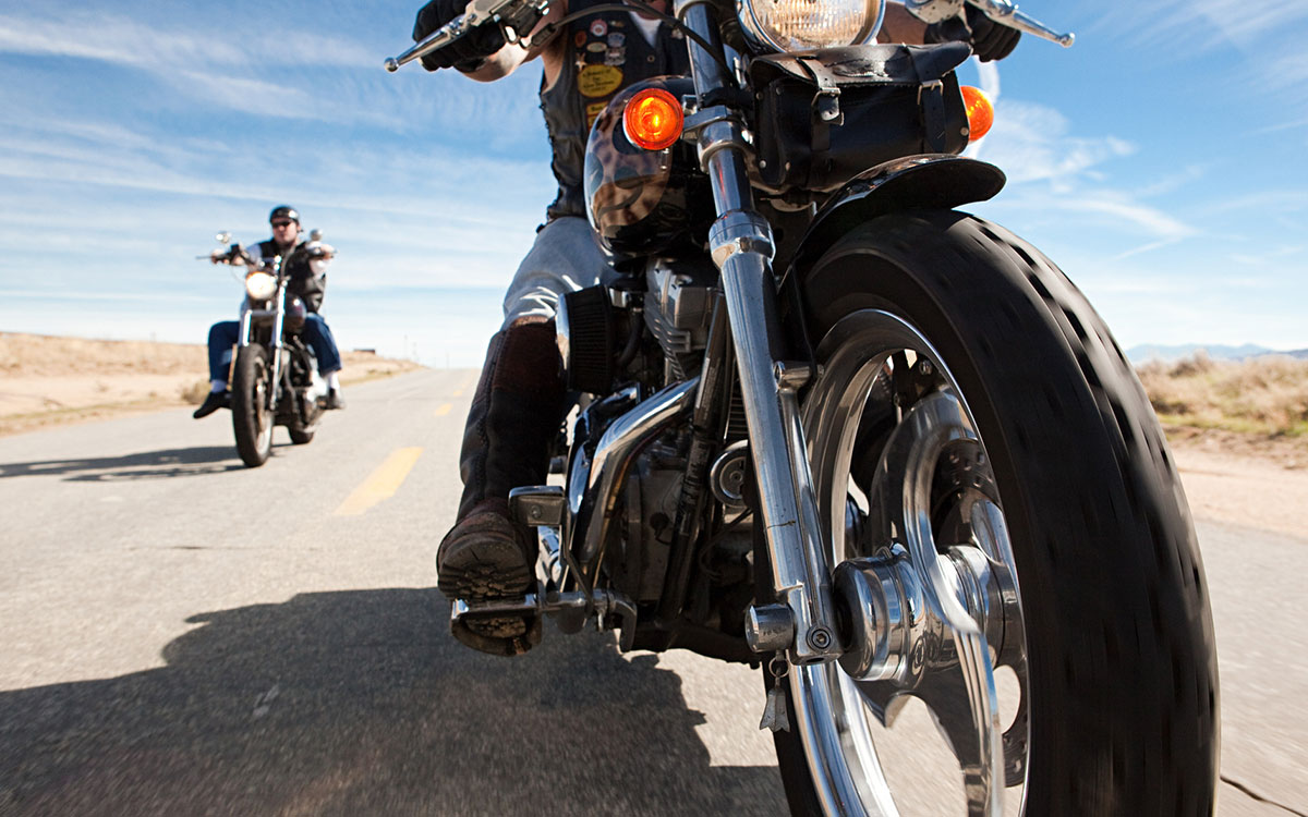 Motorcyclist suffering from hearing loss because of loud noise.