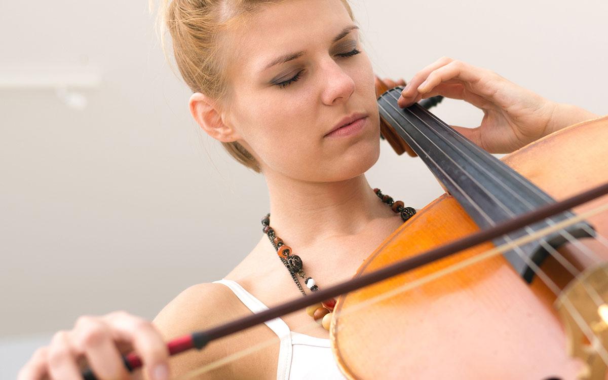 Musician playing cello.