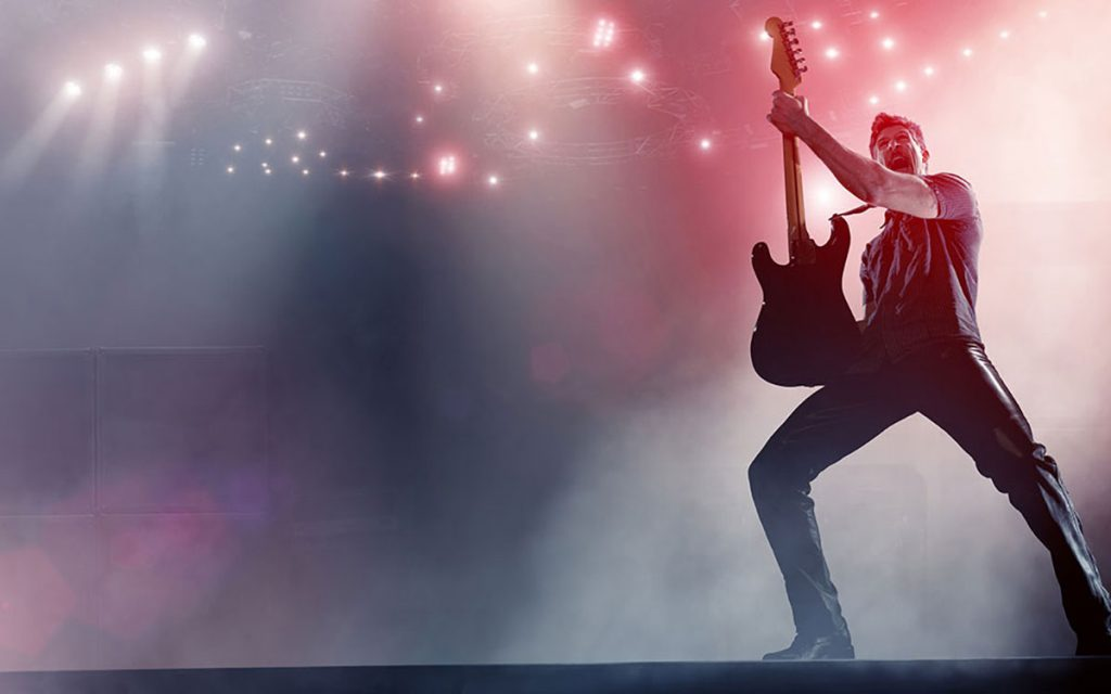 Musician on stage suffering from hearing loss.