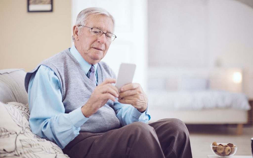 Man using his cell phone causing whistling hearing aids.