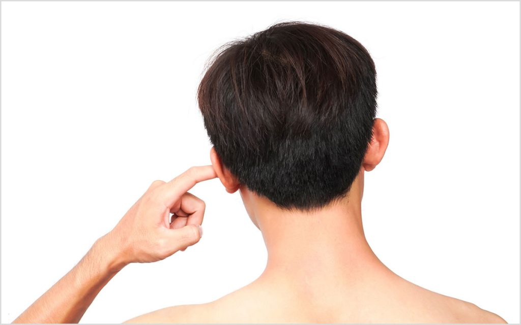 Man with his finger sticking in his ear