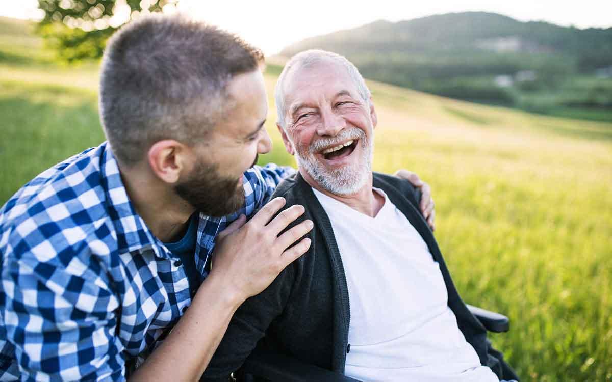 Happy man overcoming the stigma of hearing loss.