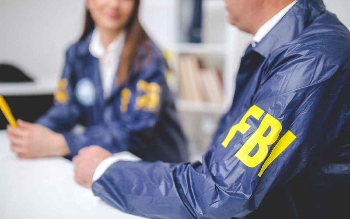People wearing FBI uniforms hearing loss.