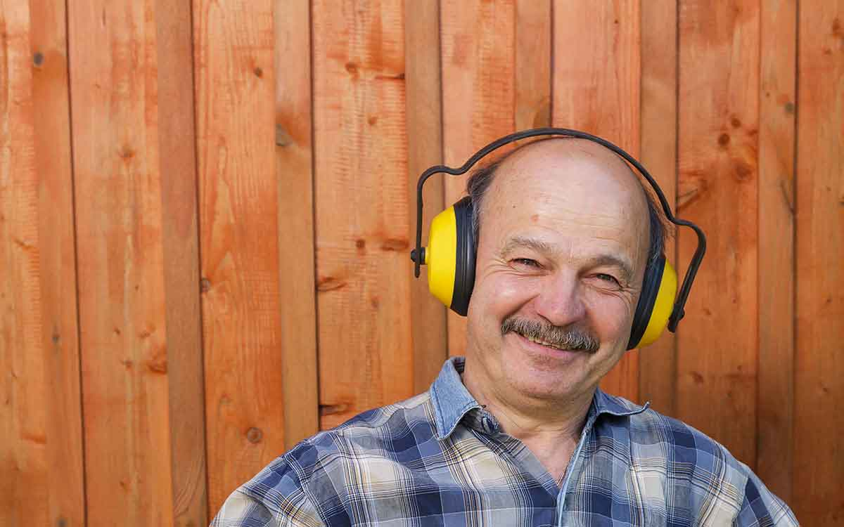 Man using hearing protection and hearing aids.