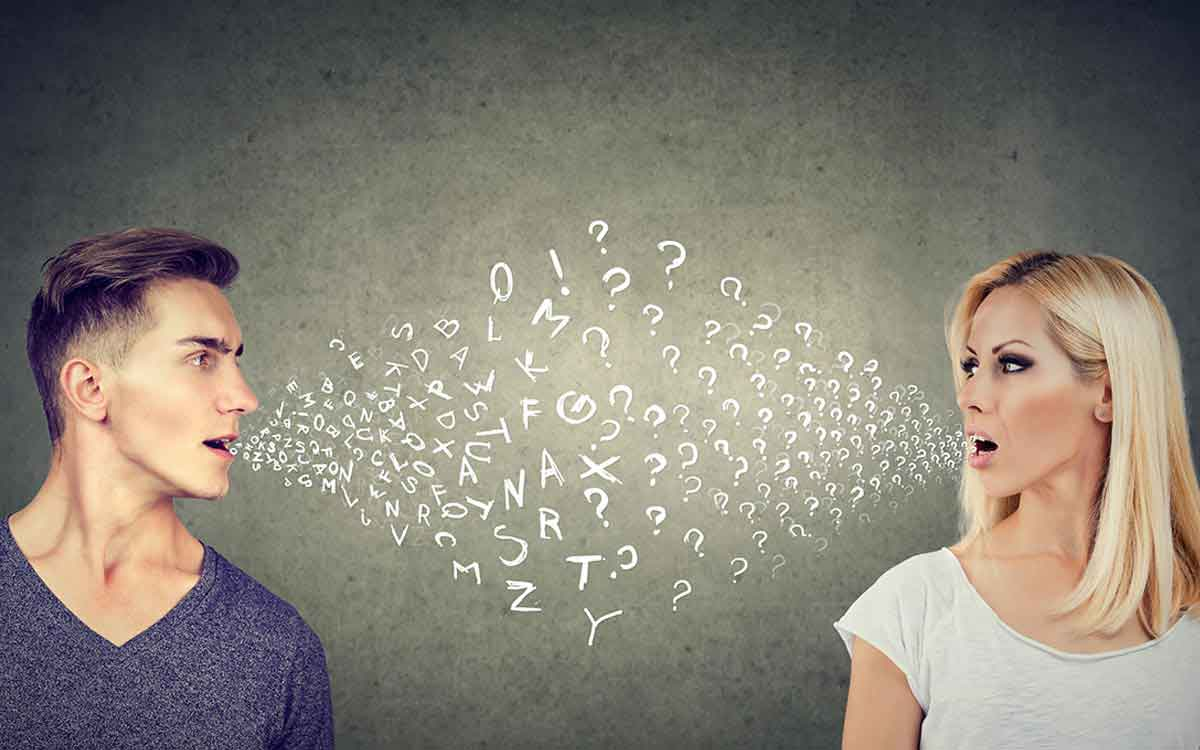 Man and woman talking to each other with letters coming out of their mouths.