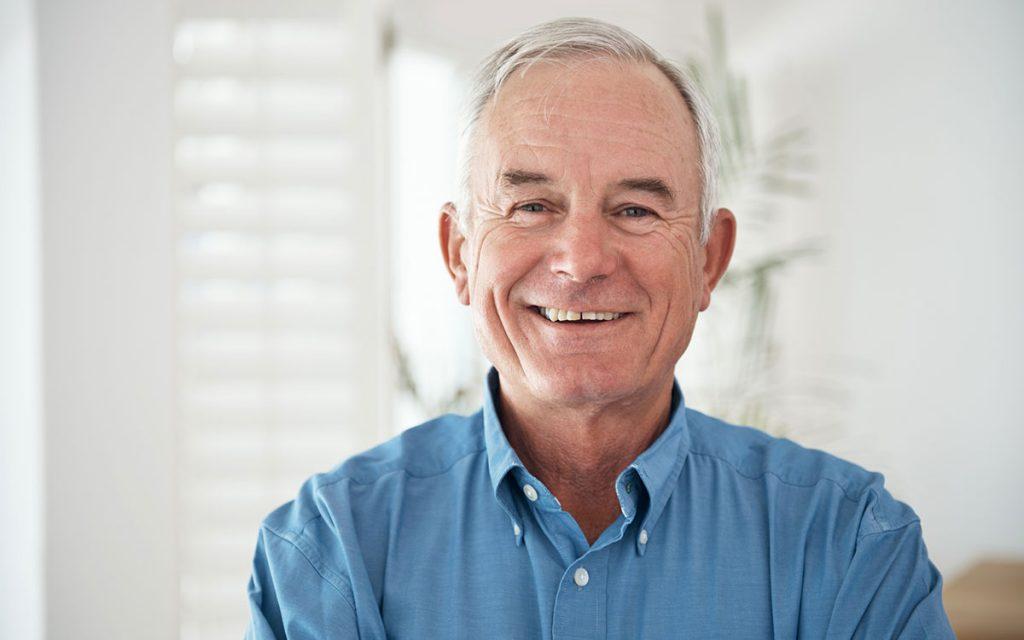 Happy senior man who's getting Tinnitus relief.