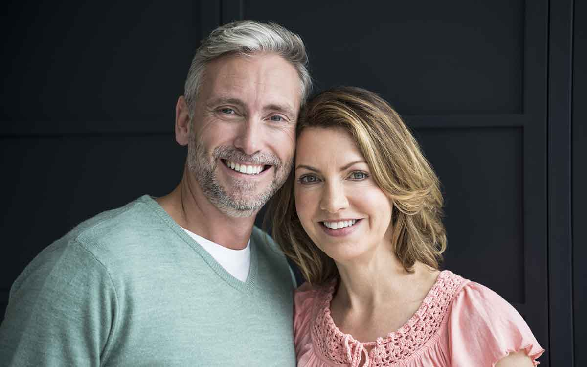 Happy couple who's relationship has improved aids.