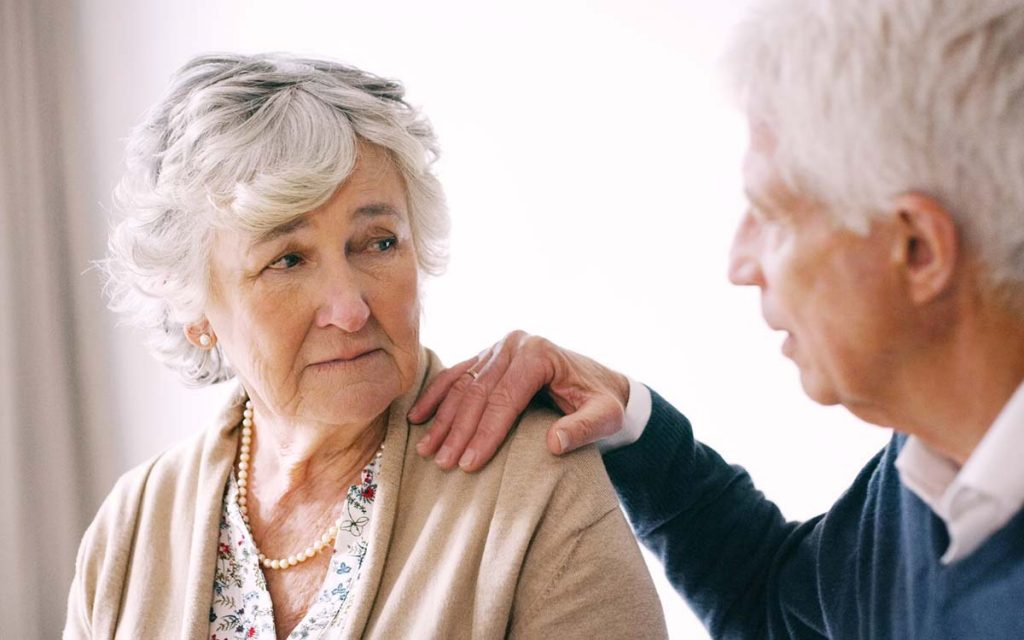 Senior couple with difficulty communicating because of hearing loss.