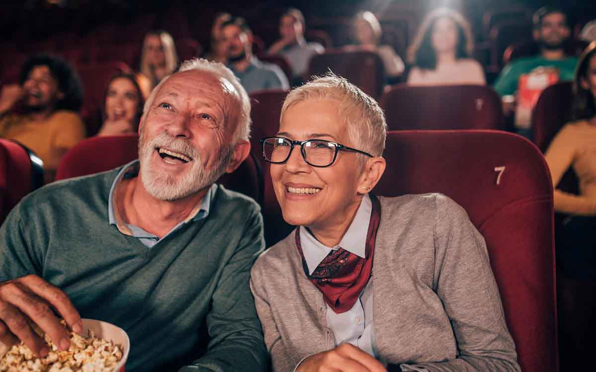 Senior couple with hearing loss in the movie theater.