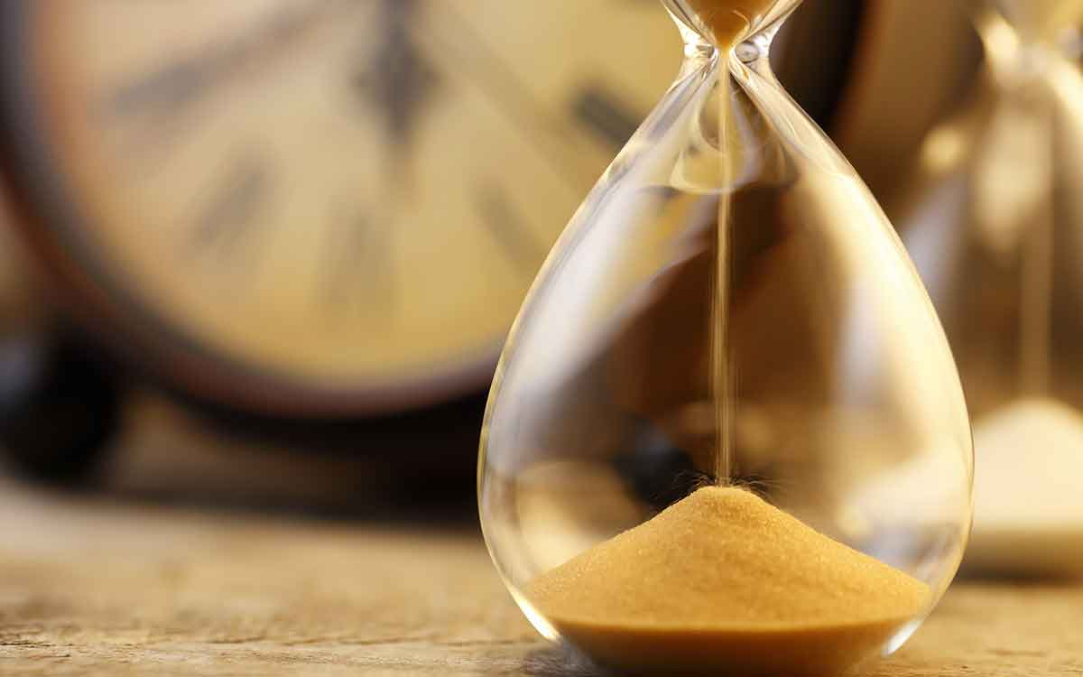 Hourglass with sand emptying representing the passing of time.