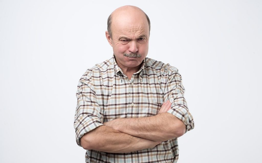 Man wondering if hearing loss is real.