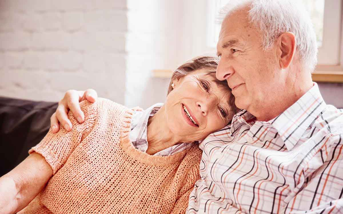 Senior couple able to remember becasue of hearing aids.