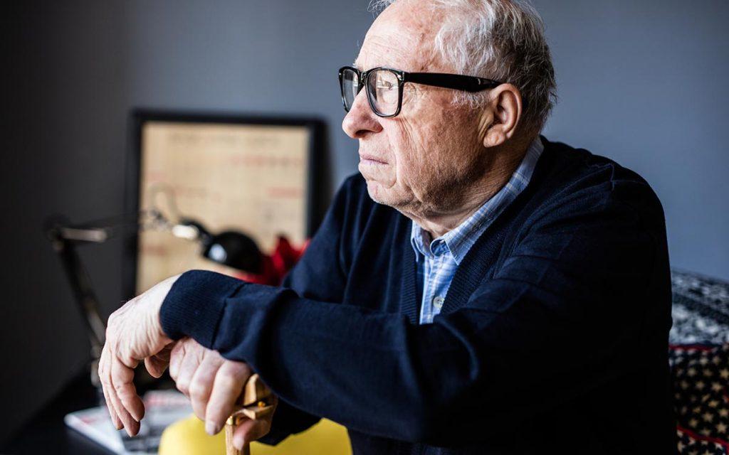Close-up portrait of a senior man sad because of Tinnitus.
