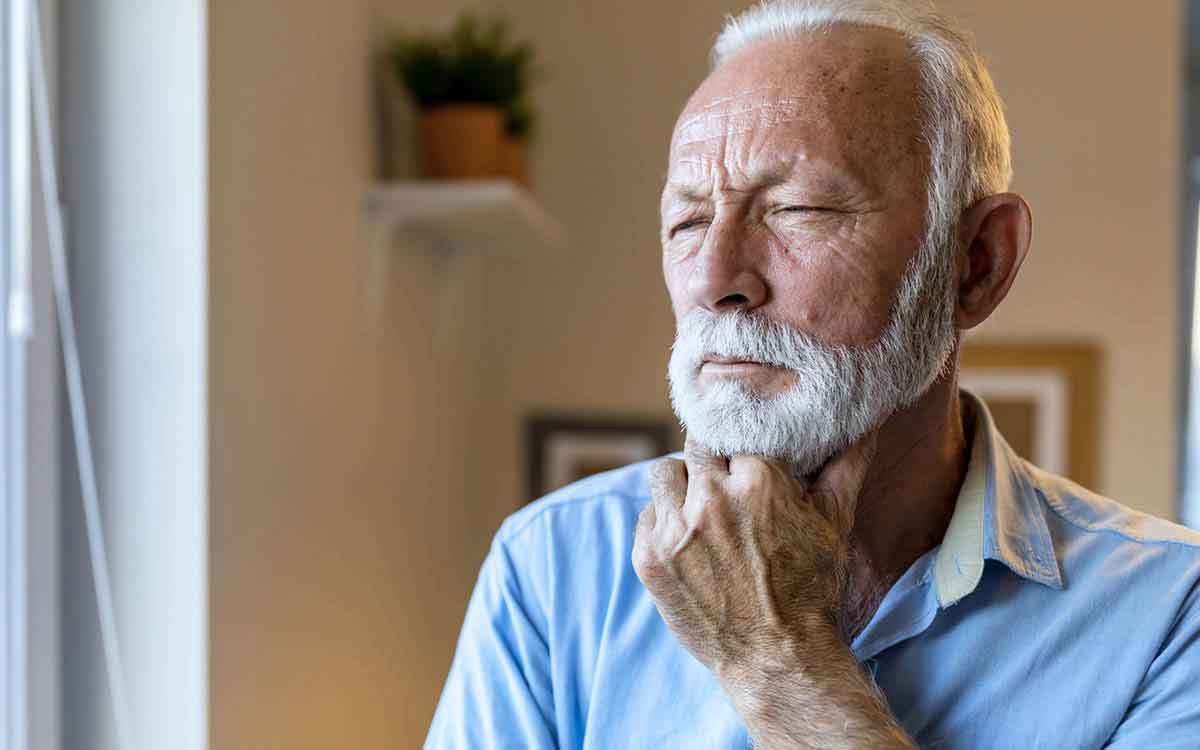 Concerned senior man who can't decide on types of hearing aids.