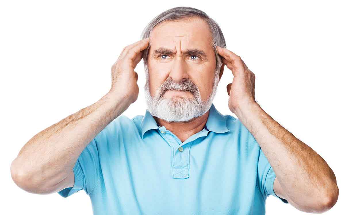 Man holds his ears because he hears a whooshing sound in his ear.