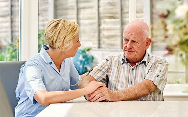 Man talking with health care provider about hearing loss.